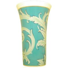 Versace by Rosenthal Arabesque Vase, large. The charm of this exclusive creation by Donatella Versace is its light and glamorous style, an expression of pure joie de vivre. The designer has created magnificient and imaginative arabesques in her favorite colors. A turquoise ocean and the elegance of Oriental patterns merge into a harmonious play of opulent form and ingenious translucency. The large Vase in this series measures 13 1/2 inches and comes in a Versace giftbox.