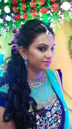 Indian bride wearing bridal hair, lehenga and jewellery. Reception look. Makeup by Swank Studio. Find us at https://www.facebook.com/SwankStudioBangalore