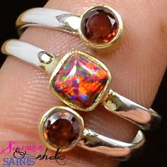 SZ 8.5 Genuine Garnet and (Lab) Fire Opal .925 SS Ring. Starting at $8 on Tophatter.com!