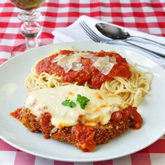 30 Minute Chicken Parmesan is my kids absolute favorite quick and easy meal; using a corn flake crumb crust for the crispy chicken keeps it tender & moist.