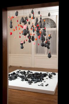 A thousand tiny deaths by Jeanne Quinn. when each balloon pops the black pot falls to the floor and smashes. Amazing idea.