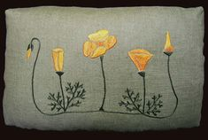 Poppy embroidered pillow from Arts & Crafts Period Textiles.