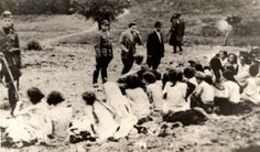 Bochnia, Poland, Jewish women being executed.  Jewish women sitting in a group, prior to being shot to death.