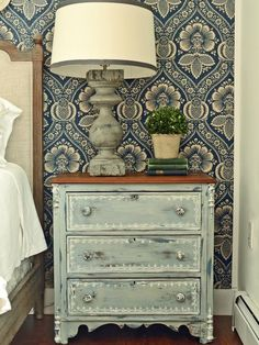 obsessed with this light blue miss mustard seed nightstand. & that wallpaper is stunning!