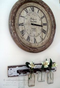 """Love the """"worn, weathered look of the clock and bracket"""