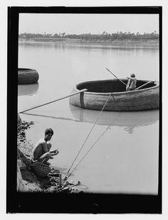 Iraq, man in round boat (qufa), man on shore  [1932]