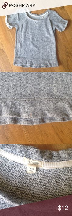 """J. Crew Short Sleeve Sweatshirt Marbled gray short sleeve sweatshirt. Rolled cuffs on arm.  Loose crewneck. There is a small stain on front hem that I can't seem to get out, otherwise in good condition.  Measures 16.5"""" across armpit to armpit and is 22"""" long shoulder to hem. J. Crew Tops Sweatshirts & Hoodies"""