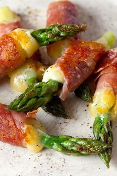 Oven roasted asparagus, melted cheese, wrapped in bacon
