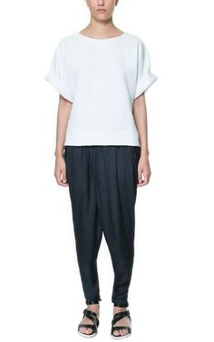 SKINNY CROSSOVER TROUSERS