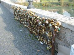 """Ponte Milvio Bridge, Rome, Italy – Love locks are gaining more and more momentum in Italy, and it all started in the Ponte Milvio bridge in Rome. The ritual in Italy is inspired greatly by a fictional event in the popular book """"I Want You"""" by the Italian author Federico Moccia."""