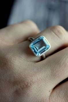 Sky Blue Topaz Emerald Cut Ring in Argentium by onegarnetgirl, $238.00    waiting for the day she makes one in aquamarine or massive morganite. this cut rocks my world