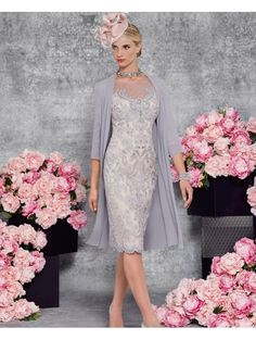 Veni Infantino 991121 Steel Blossom mother of the bride outfit from Ronald Joyce features a lace dress with long sleeves teamed with a floaty frock coat.