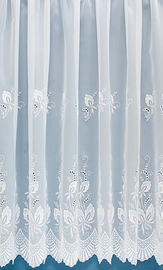 Winfarthing is a very delicately woven net curtain, adorned with beautiful satin embroidery.