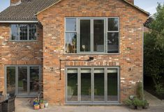 A Full House of Origin Slimline Windows House With Grey Windows, Front Doors With Windows, House Windows, Pvc Windows, Cottage Extension, House Extension Design, Barn Conversion Exterior, Brick House Colors, Types Of Bricks