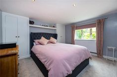 Pink and grey double bedroom, built in wardrobes. For details, contact Winkworths, Bourne. Exposed Brick Walls, Exposed Beams, Double Bedroom, Master Bedroom, Grey Painted Walls, Log Burning Stoves, Window Seat Storage, Multi Fuel Stove, Paved Patio