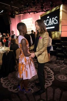 jared leto and lupita nyong'o | ... Jared Leto, Lupita Nyong'o Fete Nominees With The Hollywood Reporter.  He's all over her  :)