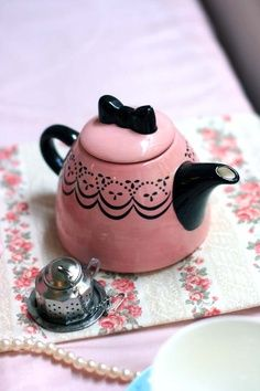 What a cute little teapot.  GRS says:  Look at the little black bow!  So cute and feminine.