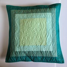 These simple pillows were perfect for me to showcase some of my new quilting designs, and today...