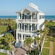 My ideal coastal living ultimate beach house! Love all of the porches, and large areas for the family to gather together.