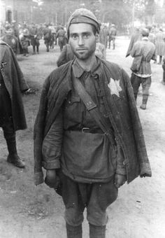 In this photo, there is a Jewish prisoner with a Jewish star on his jacket. He was captured by the Nazis, and must is now held prisoner in the camp. This picture relates to The Book Thief because Max was captured by the Nazis, and was on his way to the same fate as the soldier in this picture.