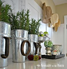 "66 Sensational Rustic Christmas Decorating Ideas Like the metal vases with the wood-look ""JOY"". (scheduled via http://www.tailwindapp.com?utm_source=pinterest&utm_medium=twpin&utm_content=post22607500&utm_campaign=scheduler_attribution)"