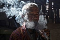 Bhutan Explored  A man smokes marijuana. Smoking in all public places in Bhutan became illegal on 22 February 2005. It became the first nation in the world to outlaw this practice outright. However, there is little enforcement. (HuffPost)