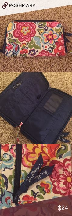 Vera Bradley Wallet/Wristlet Perfect condition! They don't make this style anymore. It completely unzips and folds open all the way Vera Bradley Bags Wallets