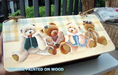 Teddies painted on wood