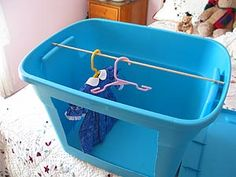 Doll wardrobe from Tupperware storage boxes, could also be used for dog clothes
