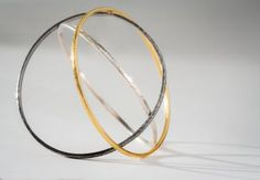 Sterling silver, oxidized sterling silver and 24K yellow gold bangle bracelets (set of three) by Gurhan #igorman #gurhan