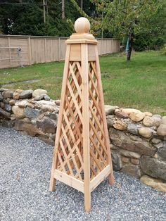 Cedar obelisk with diamond pattern panel. Panel can be easily replaced with other designs, Polycarbonate sheets or with solid panel to offer overwinter protection from snow and wind. Very versatile, stable and long lasting.