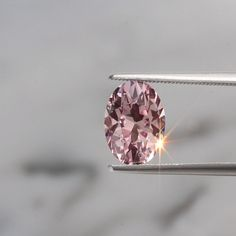 Exclusively cut by our team, this pink sapphire poised for an engagement ring speaks romantic volumes. Sapphire Rose Gold Ring, White Sapphire, Yellow Diamonds, Gemstone Engagement Rings, Rose Gold Engagement Ring, Gems Jewelry, Gemstone Jewelry, Jewellery, Sapphire Wedding Rings
