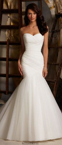 Love this criss cross mermaid style dress!! Use this quiz to determine your style of wedding dress!