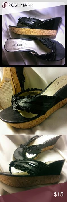 Guess cork wedges Beautiful guess thong  cork wedges .has adorable wedge heel half is cork the other is black patent leather .adorable leather strap with cute bow detail gorgeous very comfortable little wear nothing major very flattering to the foot size six and a half guess Shoes