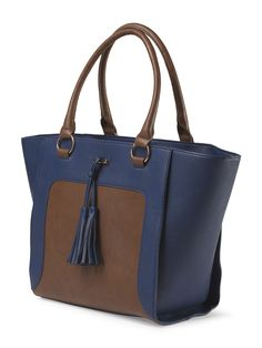 We love this classic tasseled tote... It's perfect for days on the go.