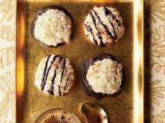 Coconut Macaroons   These sweet and chewy, five-ingredient macaroons are topped with a delicious bittersweet-chocolate drizzle.