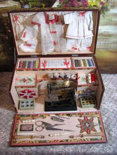French sewing kit for young girls complete with ready made factory outfits and sewing machine. These presentation kits were designed to help teach little girls to sew and needlework. c. 1890 From the collection of Victorian Retreat Antique Dolls. #DollShopsUnited