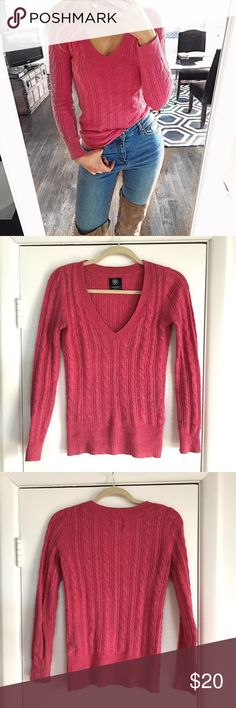 AE Pink V-Neck Sweater 💕 I wore it during one winter season but it is still in good condition. Nice and soft to the touch and very comfortable to wear. Measures approximately 25 inches from shoulder to the bottom. Says size S/P but it fits size S just fine. You don't have to be petite to wear this. 54% cotton, 26% acrylic, 15% nylon, and 5% wool. American Eagle Outfitters Sweaters V-Necks