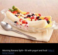 Breakfast banana split. Add yogurt and fruit