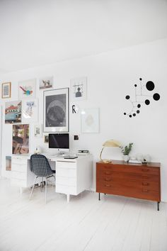 Lappalainen's Black Dots mobile, $292.22 via their Etsy shop, hangs in the work area. The desk came out of the office of a Frankfurt book publisher and the sideboard is a vintage Danish design.