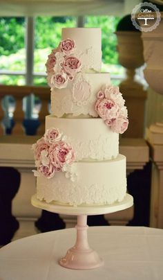 Love this wedding cake with delicate lace design and floral details; ~ Cotton and Crumbs