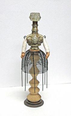 """Medium: Assemblage Mixed Media   Title: Maya   Artist: Carla Trujillo   Dimensions: 11.5""""x3""""   Materials: wood, wire, fabric, polyfi..."""