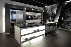 Check out this modern kitchen with a black and white modern abstract wall mural. Browse all of our black and white wall murals in our black and white section of our personally curated collection.  Also you have the ability to change any colored picture or wallpaper into a black and white photo or wallpaper with Limitless Walls!!
