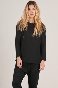 This black alpaca crew pullover is the epitome of gezellig (cozy). Pair with slacks or a skirt for the office or with harem pants at home. #EthicalFashion