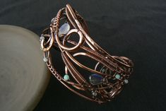 Items similar to Wire wrapped copper bracelet, Moonstone and labradorite bracelet, Wide gemstone cuff on Etsy Wire Wrapped Bracelet, Copper Bracelet, Copper Jewelry, Wire Jewelry, Jewelry Gifts, Copper Wire, Wire Bracelets, Jewellery, Jewelry Ideas
