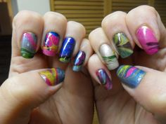 Water marble nails of many colors.