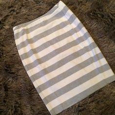 "Gray and white striped pencil skirt This gray and white striped pencil skirt is fully lined, beautifully on trend, and an amazing addition to any closet. Slit up the back. L:24"", W:16"", H:20.5"", Slit length:7"". Brand new. Size 10. Line drawn through the brand tag. Several available. Please ask me to make you a separate listing for purchase. DO NOT PURCHASE THIS LISTING. Merona Skirts Pencil"