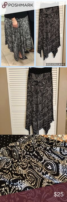 Just In 🌟 Black and White Asymmetrical Skirt Black and White Long Boho Print Skirt 🌟 Asymmetrical Shark Bite Bottom. Beautiful Skirt! PRE-LOVED work twice. Elastic waistband. Size Large 🌟 Bundle and Save 🌟 Reasonable Offers Welcomed Skirts Asymmetrical