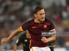 Francesco Totti of AS Roma scores their sixth goal from the penalty spot 6-0 during the pre-season friendly match between AS Roma and Sevilla FC at Olimpico Stadium on August 14, 2015 in Rome, Italy.