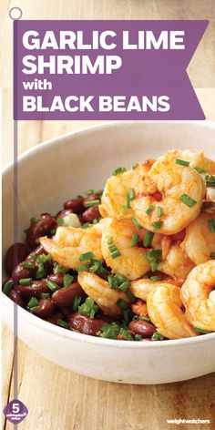 This Spanish-inspired Garlic Lime Shrimp over Cumin-Scented Black Beans recipe is a quick & easy weeknight dinner idea!